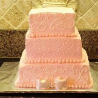 "Pink/square Wedding Cake Pink buttercream, square cakes 6"", 8"" and 10"". The border and bow were fondant. This cake design was taken from a picture..."