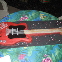Guitar Guitar cake for a girls 16th birthday. The body of the guitar was marble cake and the neck was homemade Rice Krispy treats. Details were...