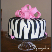 Zebra Print... Chocolate cake, torted with fudge and mocha filling. Second time doing a large bow.... need a bit more practice. Thanks for looking