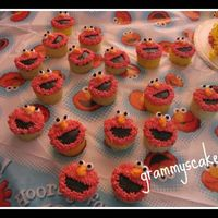 Elmo All In Their Places With Big Smily Faces..... Just about every little one loves ELMO....the birthday boy had is cake and each of his guest had their own Elmo.....TFL