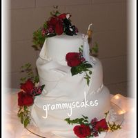 New Mr. And Mrs. White cake, raspberry tork - fondant icing and drapes...fresh roses.Thanks for looking