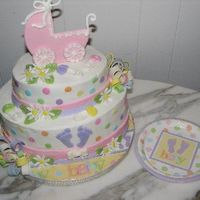 Girl Dot Baby Shower Cake   Carriage on top inspired by Boween. The pattern is in one of the Wilton yearbooks. Cake made to match the partyware.