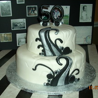 50Th Birthday Cake Contemporary design inspired by the many pictures on cake central!! Covered in MMF