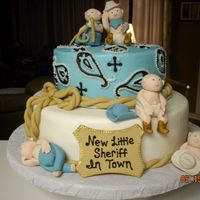 New Little Sherrif In Town This was for a western themed baby shower. Fondant/gumpaste figures. Cake is all Buttercream icing
