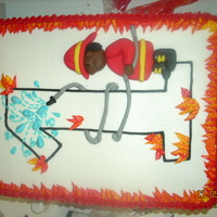 Fireman 1St Birthday This was inspired by a coloring page for a fireman themed first birthday party. Flame border, buttercream icing with fondant fireman boy.