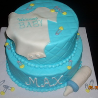 Baby Max Buttercream with fondant onsie and baby bottle. I used a diamond impression mat with viva papertowel to do the diamond pattern.