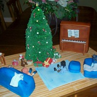Christmas At Home.. the tree, piano, couch, chair, and ottoman are all cake. The rest is all made of gumpaste. Served 125.