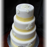 Yellow Gingham And Royal Icing Daisies 4 tiered stacked fonadant wedding cake.