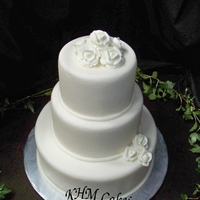 3 Tiered Round Fondant Wedding Cake with royal icing roses for ivory and chocolate color themed wedding. Very simple.