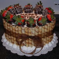 Mmmmmm.....chocolate!  Choclate cake with strawberry cream filling. Iced with bc, chocolate hazelnut rolled cookies and chocolate dipped starwberries. I wish I...