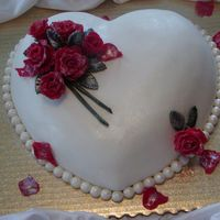 Valentine Cake Fondant covered heart cake with pearl border and candy clay roses.