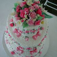 Valentine Wedding Cake. White cake, vanilla buttercream frosting with fondant flowers.
