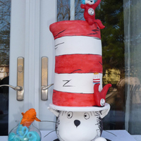 "Cat In The Hat I baked 5 6"" rounds. Split them. then built 3 mini cakes. Each had 3 half layers, cake-SMBC-cake-Ganache-cake-SMBC. Then I stacked the..."