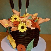 Fall Flower Bouquet Cake Fondant flowers, and chocolate fondant woven basket.Normally I will acknowledge any inspiration I have for cakes. But this cake was just...