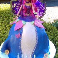 Fairy Barbie Cake Fairy Barbie is a full doll. Skirt is Yellow cake filled with Lemon Curd and fresh strawberry, covered in Fondant.