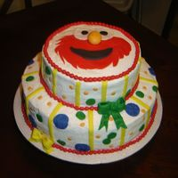 Elmo Cake   This is a 2 tier..4 layer amaretto cake...iced in buttercream with fondant accents.