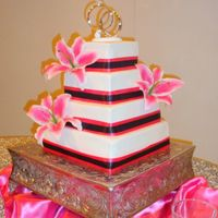 Kami's Wedding Cake This is just a simple fondant covered square cake with real ribbon and silk flowers.