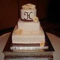 Ivory Fondant Wedding This cake has forndant and handmade gumpaste flowers.