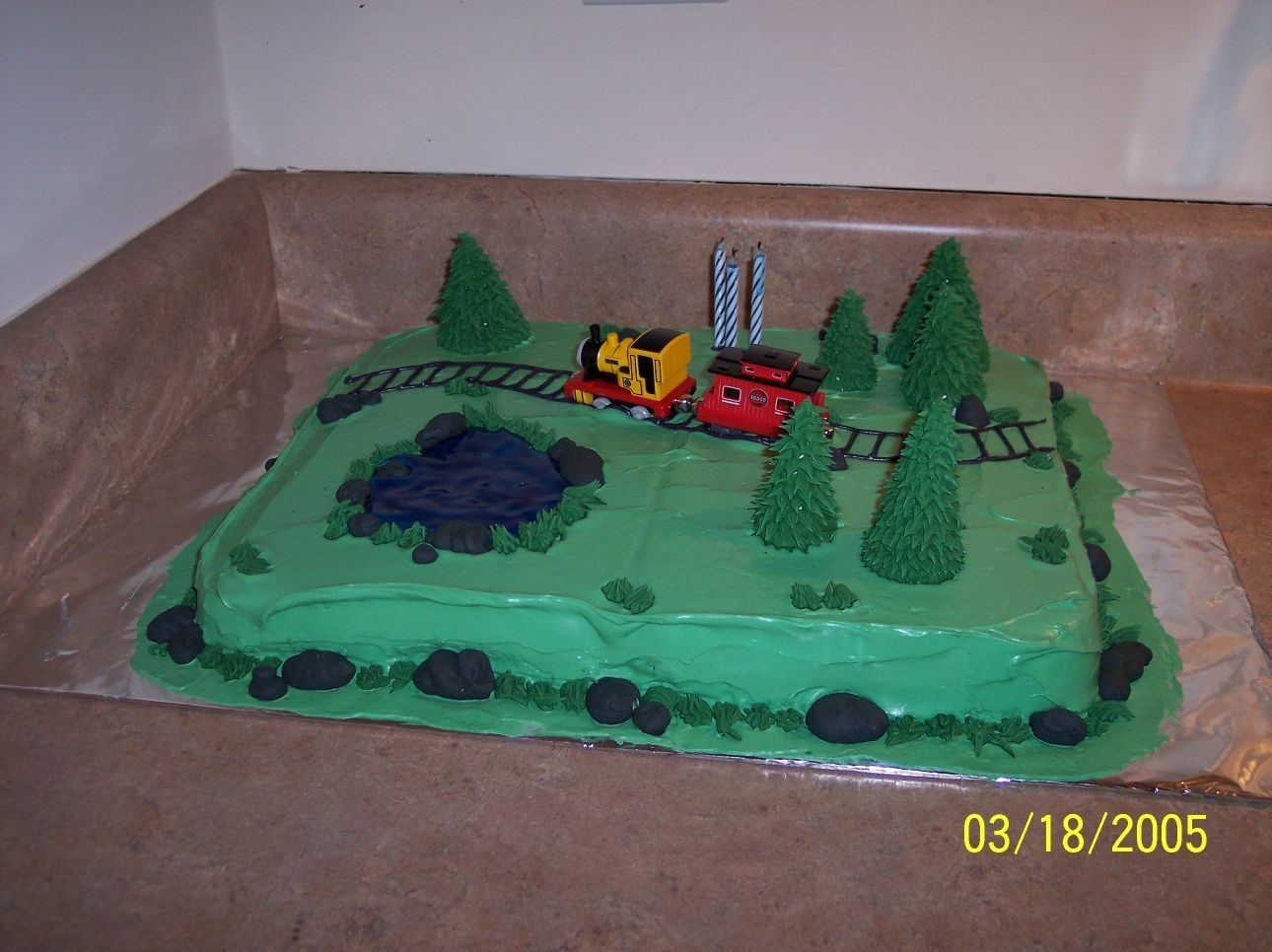Train Cake This was my first attempt at a more creative cake. Our son was turning 3 and in love with trains. It is a gluten-free cake with buttercream...
