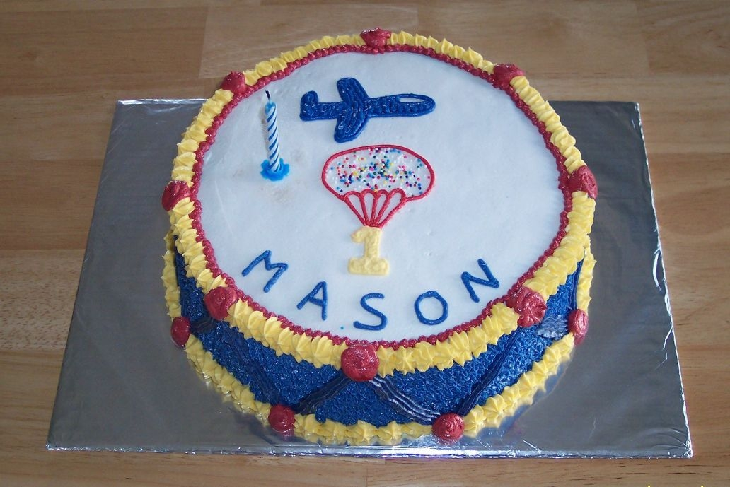 "Drum Cake My youngest son's first birthday. All buttercream. We are a military family so his ""1"" is parachuting in."