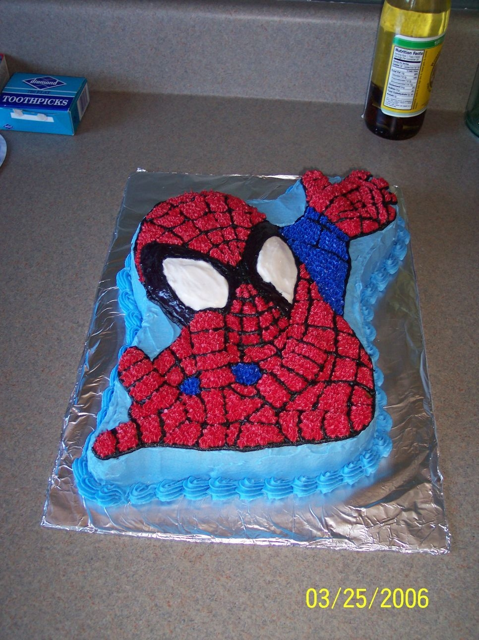 Spiderman My son discovered superheros and just had to have spiderman. Yellow cake, all buttercream. Man, that's a lotta stars!