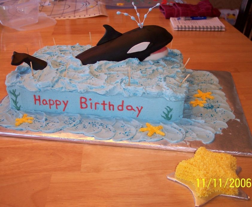 Shamu For a double bday for my nephews (1 and 3). Shamu is a carved almond sour cream pound cake covered in fondant. Base cake is a white scratch...