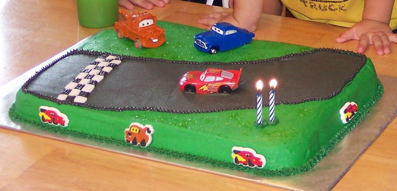 Cars Yellow cake, buttercream icing. BC and fondant finish line and toy cars. Simple but the two year old loved it!