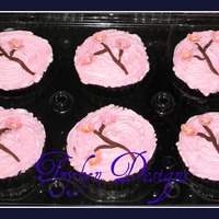 Cherry Blossom 5 dozen 1/2 choc./choc fudge and 1/2 french vanilla/buttercream. cherry blossoms made from gumpaste. TFL