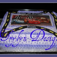 Cars 1st Birthday cake. 1/2 choc,1/2 french vanilla/cookies and cream. Buttercream with edible transfer and fondant. Design provided by customer...