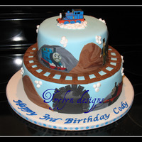 Thomas The Tank Engine 3rd Birthday...Thomas The Tank Engine. This is the 3rd time I have done this cake. Top tier choc/rasp. cc, bottom tier french vanilla/rasp...
