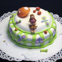 Garden Dream Chocolate cake with Caramel Fudge filling. All decoratons are made in MMF except the little girl