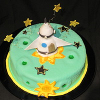 Blast Off Vanilla cake with dulce de leche filling. Cover in MMF everything is MMF except the sun and the stars which are gumpaste.