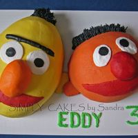 Bert And Ernie Yellow cake with Chocolate filling. Iced in BC. Thanks for all the inspiration in this site. All is cake but the ears.