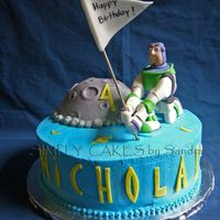 Buzz Lightyear Buzz Lightyear cake for a 4 years old kid. Half chocolate, half yellow cake with strawberry filling. Moon was chocolate cake. Buzz...