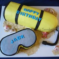 Scuba Tank Scuba tank carved out of a square pan. Marble cake with Chocolate filling. Covered in MMF and sand made out of vanilla cookies. Tanks so...