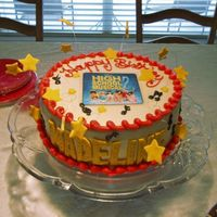 Can You Stand Another High School Musical Cake? This was for my child and I DON't have access to EI's so I cheated and laminated a paper image for this cake, stars and letters...