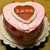 Valentine's Heart Shaped Cake This cake was french vanilla with strawberry mousse filling, covered in whipped buttercream frosting tinted pink. The red heart and the...
