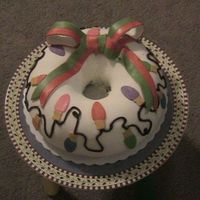 First Cake This was my first adventure with fondant. My sister did most of the work, I just put on the lights and cording. It was still fun to do none...