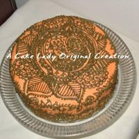 Mehendi Cake Eggless chocolate cake iced in saffron color BC with mehendi green henna pattern. Great for Indian bridal shower or sangeet party, hafla,...