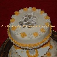 Ganesha Chaturthi This was my first decorated cake for Ganesha Chaturthi a couple years back. Eggless coconut cake with mango filling, iced in BC with silver...