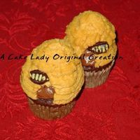 Honeybee Cupcakes Chocolate cupcakes topped with chocolate mousse, decorated in BC with chocolate bees.