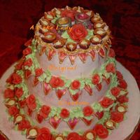 Deepawali Cake, Side View Eggless 3 tier coconut cake, iced in rose BC with BC and chocolate accents.