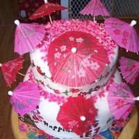Cherry Blossoms And Umbrellas Cake covered in mmf with stenciled characters, writing and flowers painted using food coloring and extract. MMF cherry blossoms all over...