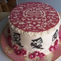 "Asian Inspired Cake With Chocolate Topper Small 6"" cake . Whole top of cake is chocolate topper out of white chocolate (made red) traced over design on wax paper and filled in..."