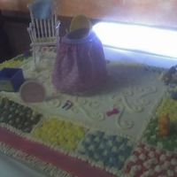 Baby Shower Cake I made this for a friend, it is suppose to be a rug and I put a bassinetontop and some toys