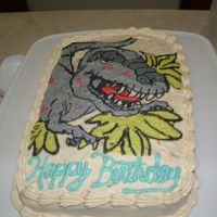 T-Rex I made this cake for my son's 6th birthday. I used a page out of his coloring book. I used the FBCT method. This is the second time I...