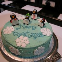 Fondant Penguins My first time with MMF. Managed to do the figurines. Tried covering the cake, but... didn't quite turn out as planned. Snowflakes were...