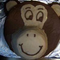 Madi's Monkey Cake  My niece wanted a monkey cake for her family party. This is it. I copied it from someone on here but I have no idea who - sorry. The nose...