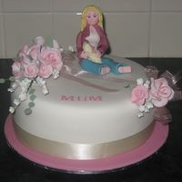 Mothers Day Cake   made for a mothers day fundraiser. Fruitcake iced in fondant. Female figure inspired by ains2's tutorial