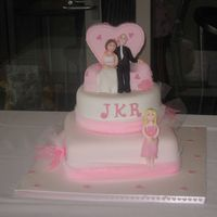 Love Seat Wedding Cake   made for friends, a couple on a love seat for their pink themed wedding